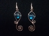 Plated silver earrings with blue glass bead