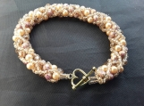 Beautiful hand beaded bracelet in champagne colours. This can be ordered in lots of different colour combinations.Each one is unique.