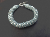 Elegant white pearl crystal and turquoise glass seed bead bracelet lovely and  summery or for bridal occasions.