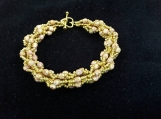 Hand beaded bracelet in gold tones all glass beads.