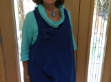 Navy fleece wrap vest with matching flower pin