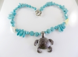 Turquoise beaded necklace with sea turtle