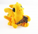 Clay bright yellow baby dragon with medical caduceus