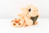 Clay peach baby dragon  sculpture figurine with gold heart