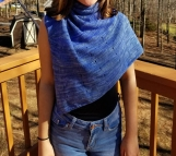 Lightweight knit shawl in a fingering weight merino wool