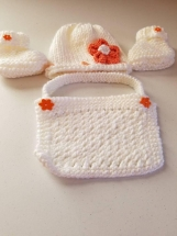Baby girl set hat, bib booties. White orange accents