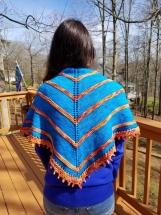 Bright and beautiful hand knit shawl of superwash merino wool