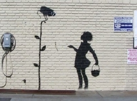 Banksy Los Angeles mural Flower Girl.