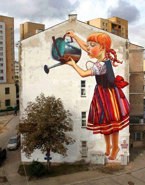 Street art, girl watering tree.